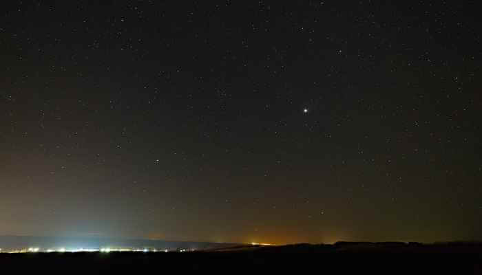 Planet Jupiter in the night starry sky
